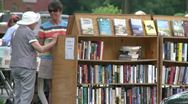 Stock Video Footage of Books being displayed at an outdoor book fair (1 of 4)