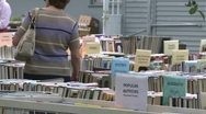 Stock Video Footage of Books being displayed at an outdoor book fair (2 of 4)