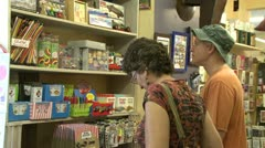 People looking at various items at a general store (1 of 2) Stock Footage