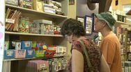 Stock Video Footage of People looking at various items at a general store (1 of 2)