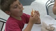 Young boy eating large sandwich (2 of 2) Stock Footage