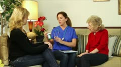 Home health care nurse explaining prescriptions Stock Footage
