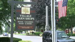 A quaint wooden sign for Village Barn Shops Stock Footage