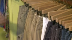 Man looking at a pant rack in a Country Store Stock Footage