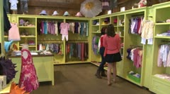 Women looking at different items at a Children's Boutique (1 of 4) Stock Footage