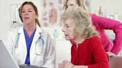 Doctor talking to the patient and daughter Stock Footage