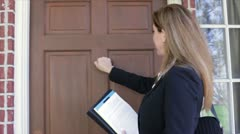 Saleswoman coming to the door Stock Footage