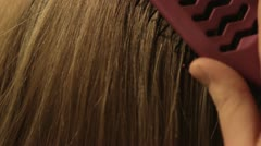 Close Up Brushing Hair - stock footage