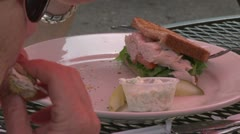 Person eating a Club Sandwich (1 of 2) Stock Footage