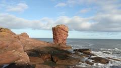 Deil's heid sea stack near Arbroath Angus Scotland Stock Footage