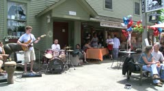 Guitar player and drummer playing in front of a Country Store (1 of 2) Stock Footage
