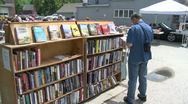 Stock Video Footage of Books being displayed at an outdoor book fair (4 of 4)