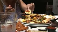 Stock Video Footage of People enjoying Nachos (3 of 3)