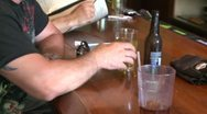 Man drinking a beer at a bar Stock Footage