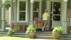 Two people entering a Country Store Stock Footage