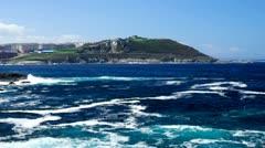 Atlantic ocean waves break along the coast of La Coruna, Spain. Stock Footage