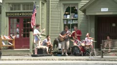 Small band Playing in front of a Country Store Stock Footage
