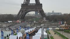 Christmas market and Eiffel tower paris winter celebrations holiday Stock Footage