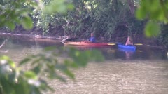 Kayakers on a secluded part of a river (1 of 3) - stock footage