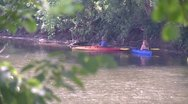 Kayakers on a secluded part of a river (1 of 3) Stock Footage
