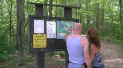 A couple looking at a trail map for Bulls Bridge Recreational Facility (1 of 2) Stock Footage