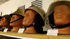 Head mannequins in military caps Stock Footage
