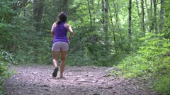 A girl hiking and spraying insect repellent on herself Stock Footage