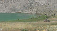 Brink of crater lake zoom in - stock footage