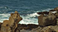 Stock Video Footage of Moon Rocks and Roiling Sea at Salt Point Coast