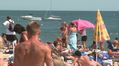 People sunbathing at a sandy beach (2 of 2) Stock Footage