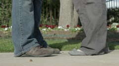 Feet in front of Flower Bed Stock Footage
