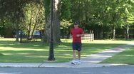 Stock Video Footage of Man jogging across street (1 of 1)