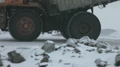Heavy mining dump trucks driving along the opencast Stock Footage