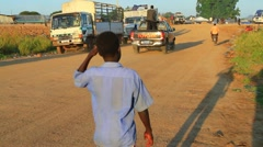 Young Boy on Road Stock Footage