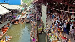 Timelapse - Damnoen Saduak Floating Market near Bangkok, Thailand Stock Footage