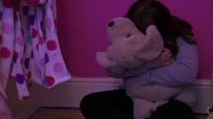 Mid of lonely child hugging toy 1 of 4 Stock Footage