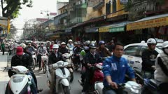 Everyday city life with people and traffic, Hanoi, Vietnam, Asia - stock footage