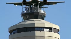 Jet Flies Over Airport Control (radar) Tower for Air Traffic Control - stock footage