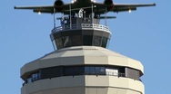 Stock Video Footage of Jet Flies Over Airport Control (radar) Tower for Air Traffic Control