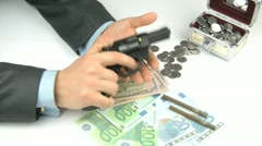 Man with a pistol and money. Stock Footage