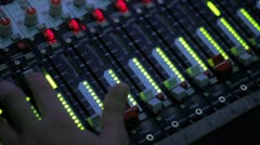 Stock Video Footage of Studio 11 -  A studio director during setting up a mixing desk in a TV studio