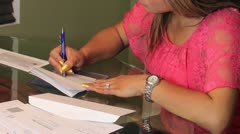 Writing Check Paying bills Hispanic Woman - stock footage