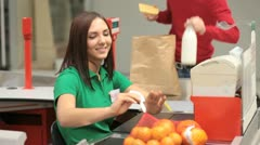Smiling cashier - stock footage