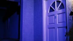 Burglar with pistol comes through front door Stock Footage