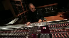 Recording Studio engineer bobbing head mixing music at Console 06 Stock Footage