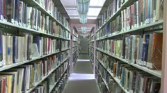 Rows of books on shelves in the library (2 of 3) - stock footage