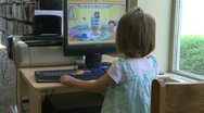 Stock Video Footage of Small child using a computer at the library (1 of 3)