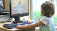 Stock Video Footage of Small child using a computer at the library (2 of 3)