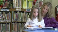 Stock Video Footage of A child getting books for her mother to read to her (3 of 3)