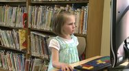 Stock Video Footage of Small child looking at the computer screen in the library